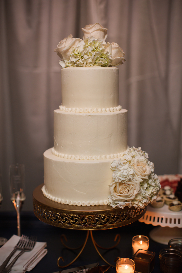 Three-tiered white wedding cake at The Beaufort Inn