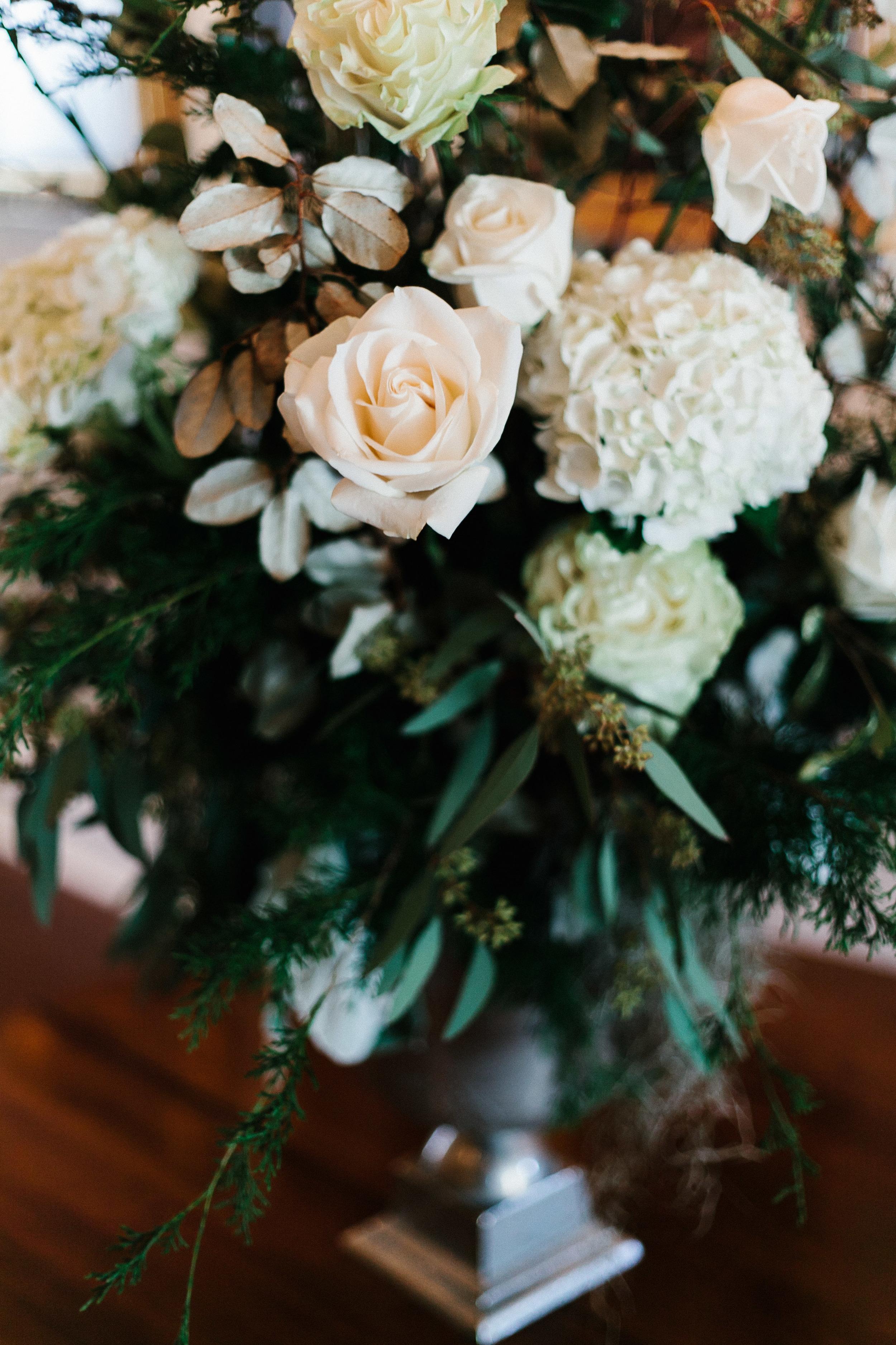 White rose and hydrangea centerpieces at winter wedding in Stillmore, GA by Mark Williams Studio