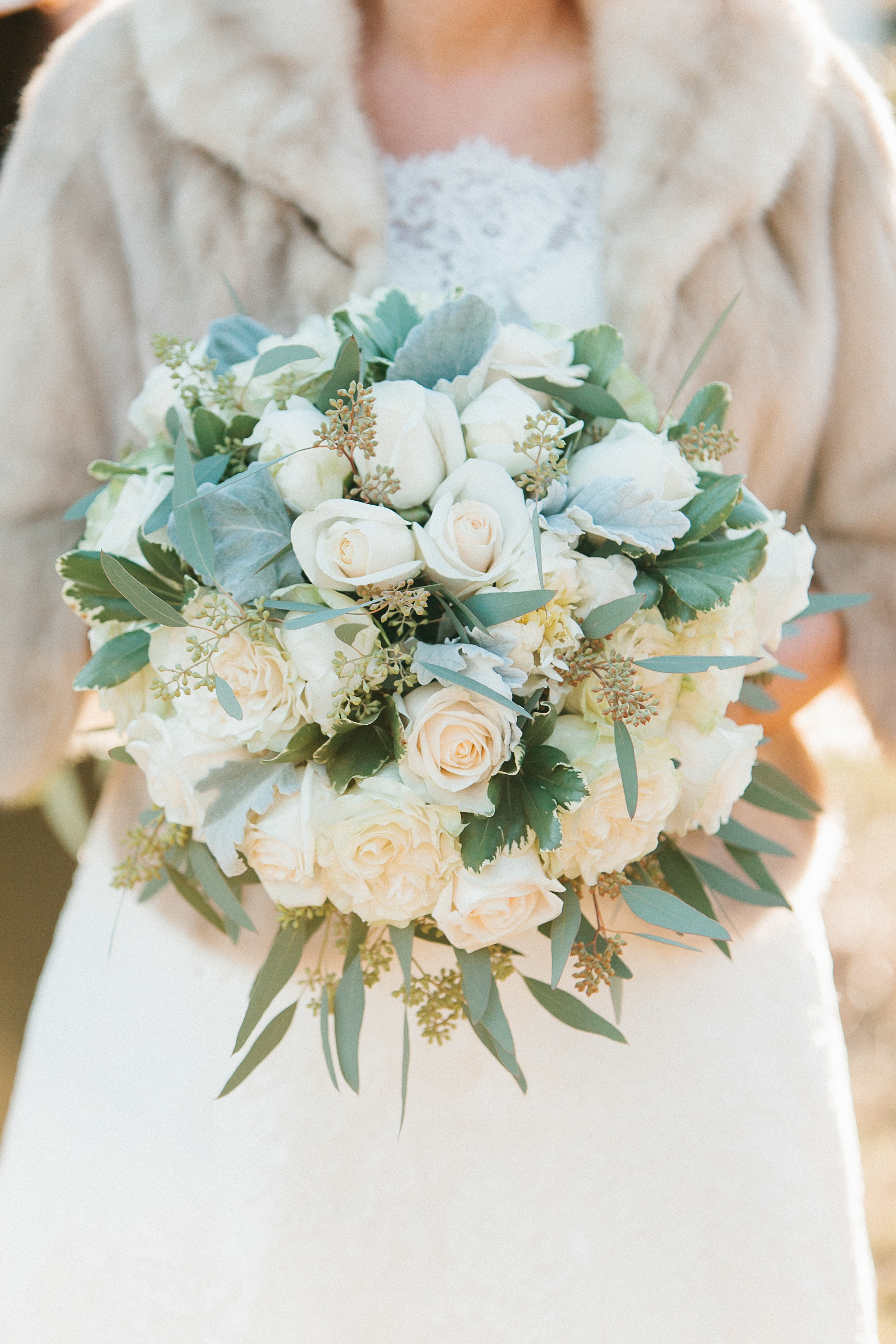 White rose, eucalyptus and dusty miller wedding bouquet
