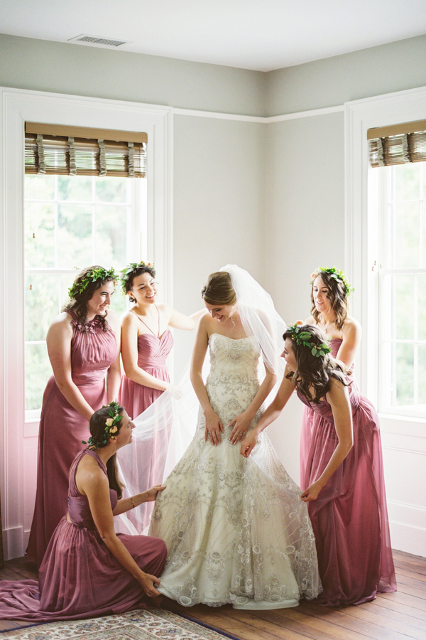 Bride prepping for Charleston wedidng with bridesmaid by JoPhoto