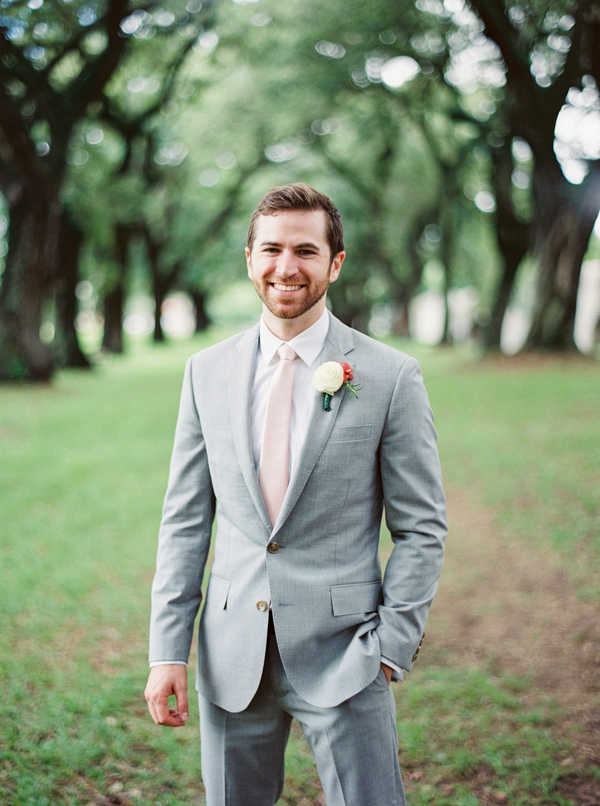 Groom in grey suit with pink tie at Charleston, SC wedding