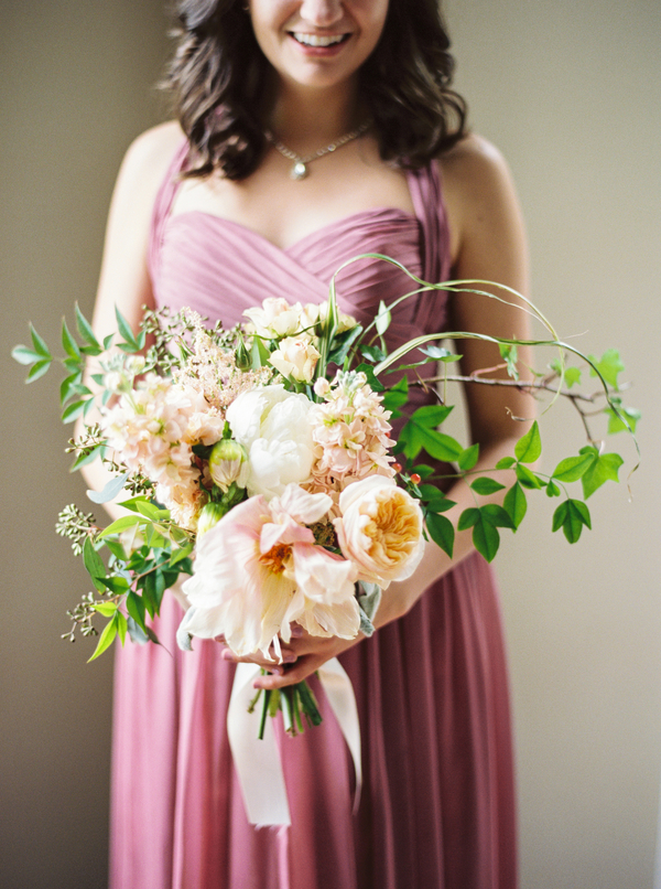 Garden-style bouquet by Confetti of Charleston and antique rose bridesmaids dresses