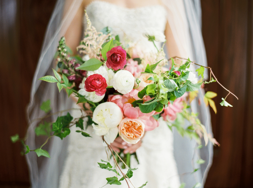 Garden rose, ranunculus and astilbe bouquet by Confetti of Charleston