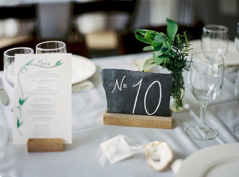 Handmade slate table numbers at Charleston, SC wedding