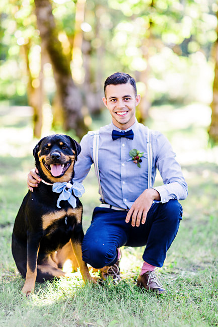 Groom wearing suspenders with his rescue dog at Portland wedding elopement