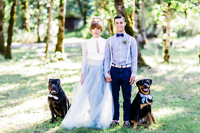 Bride and groom with rescue dogs wearing bow ties