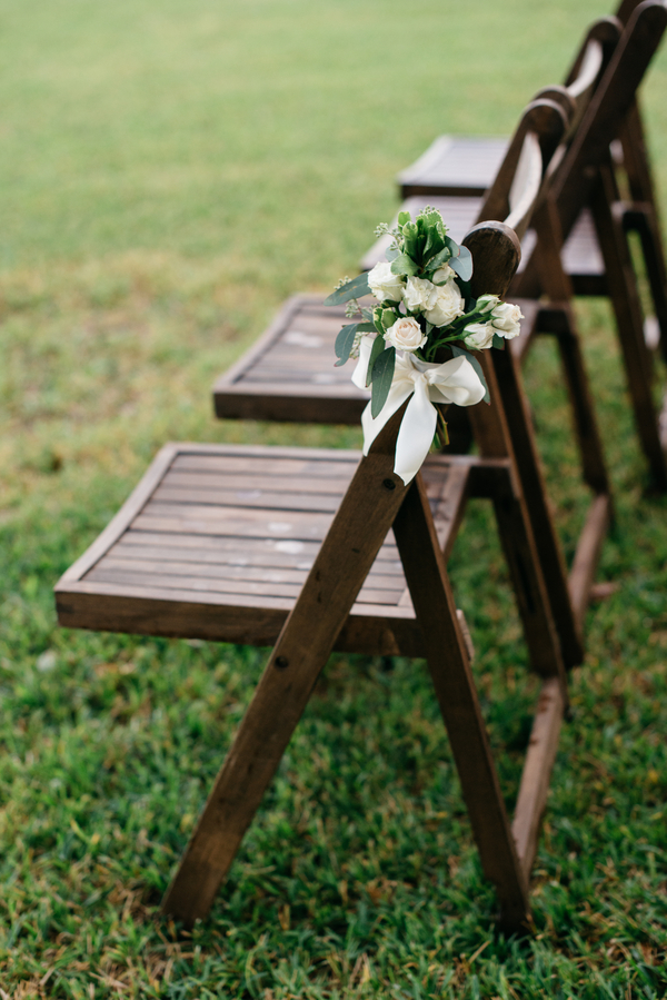 Outdoor wedding ceremony aisle markers by Sweet Magnolia Flowers in Charleston, SC