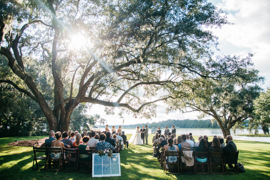 Outdoor wedding ceremony on the water at Oak Point Plantation
