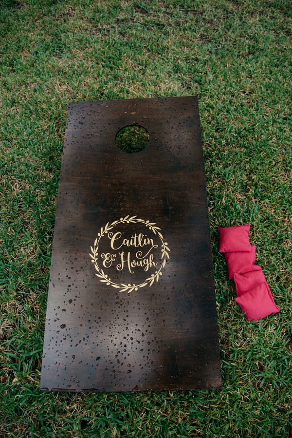 Cornhole set at outdoor wedding by Cana Dunlap Photography