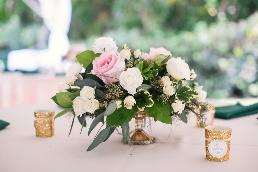 Centerpiece of roses by Sweet Magnolia Flowers