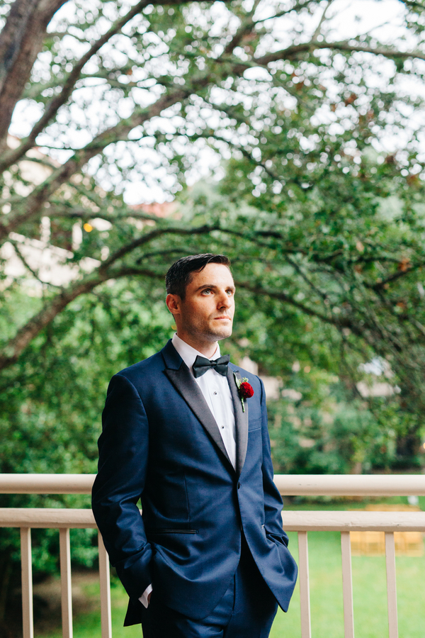 Navy blue tuxedo with black lapels and bow tie at Charleston wedding