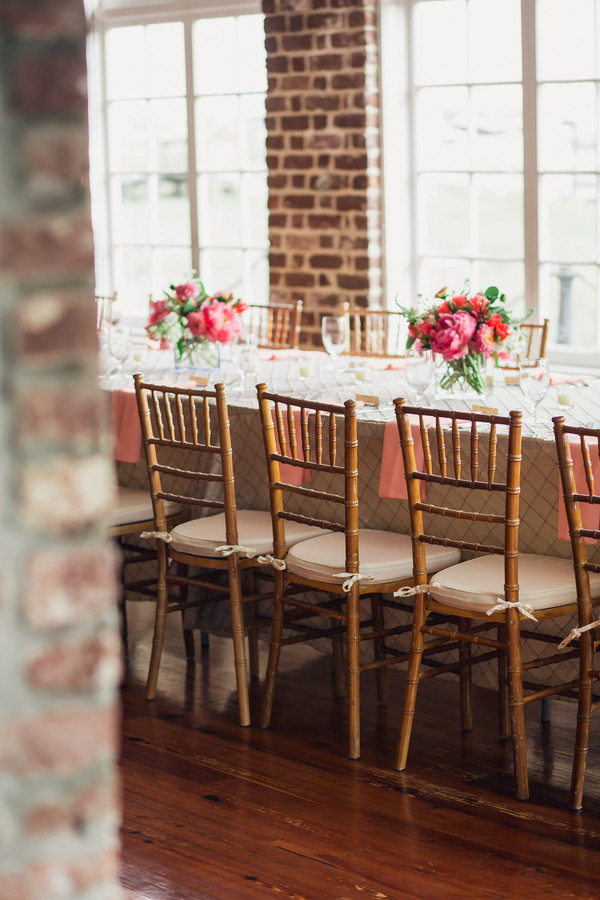 Pink Peony wedding centerpieces and gold chivari chairs by Pretty Petals of Charleston