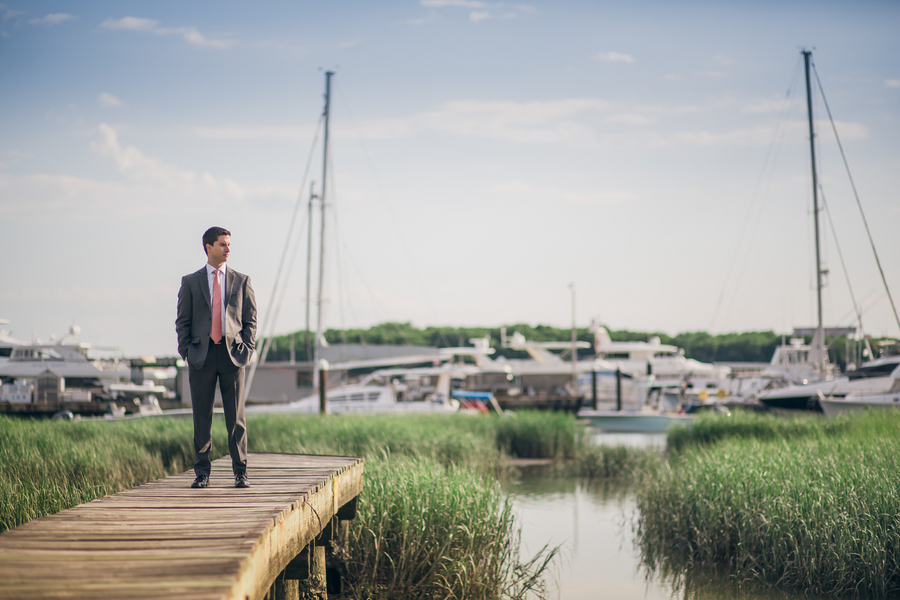 Groom in grey suit at Charleston City Marina