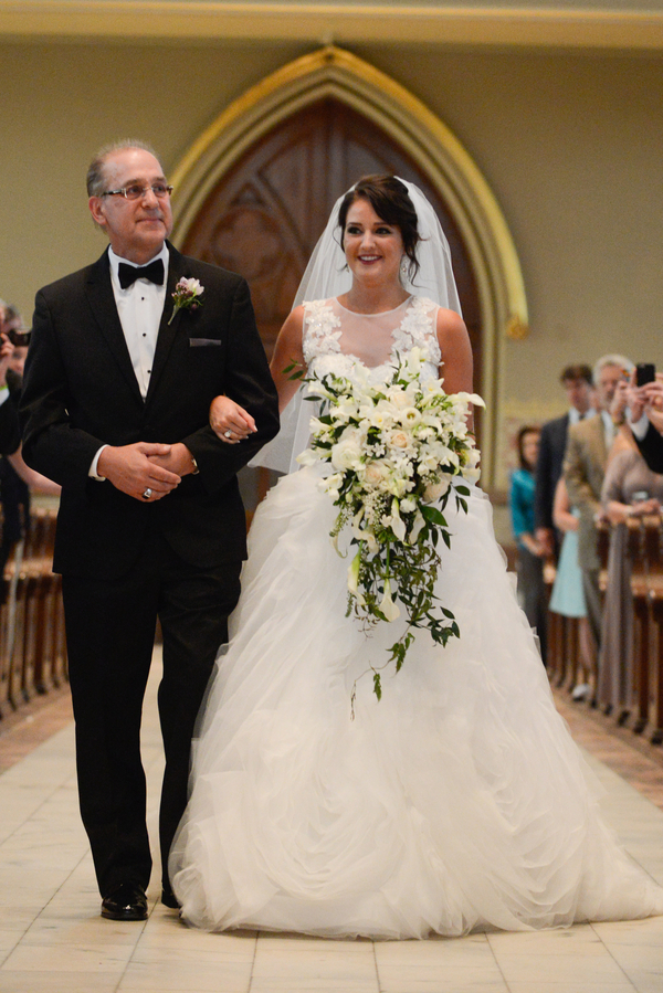 Bride walking down the aisle at Cathedral of St. John the Baptist