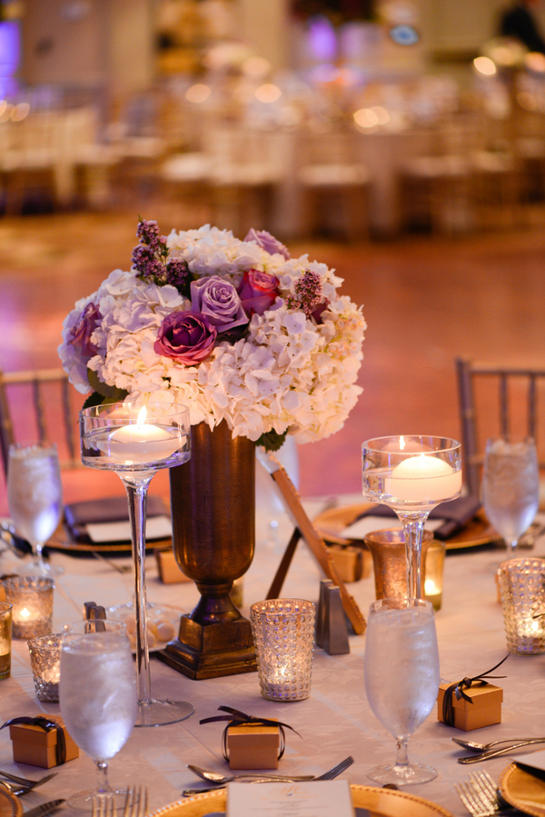 White hydrangea and purple and lavender rose centerpieces by Harvey Designs
