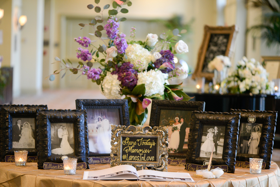 Guest book table with vintage family portraits