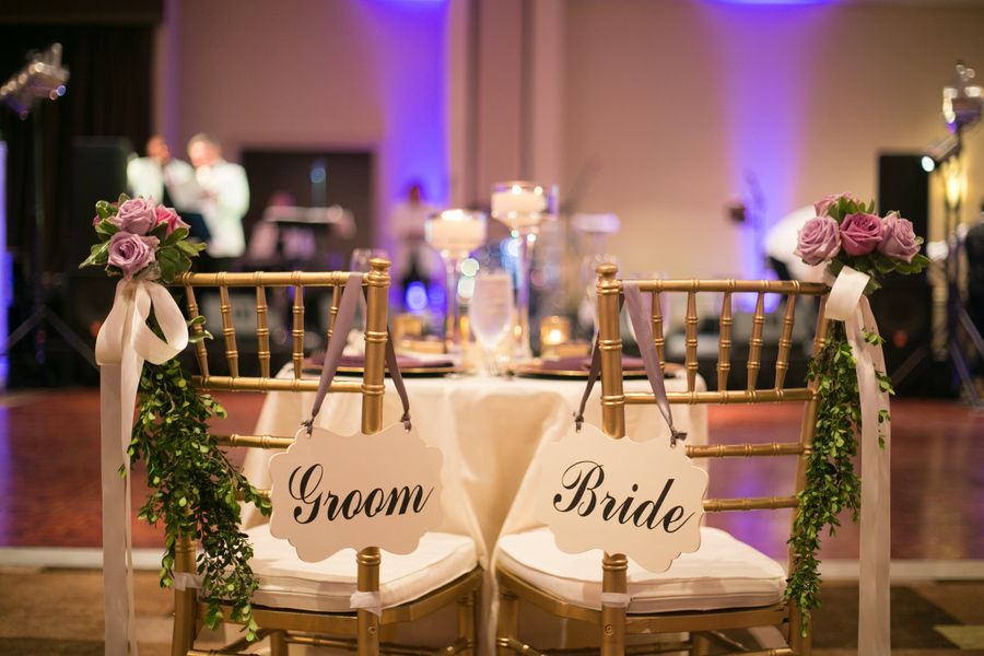 Sweetheart table bride and groom chairs