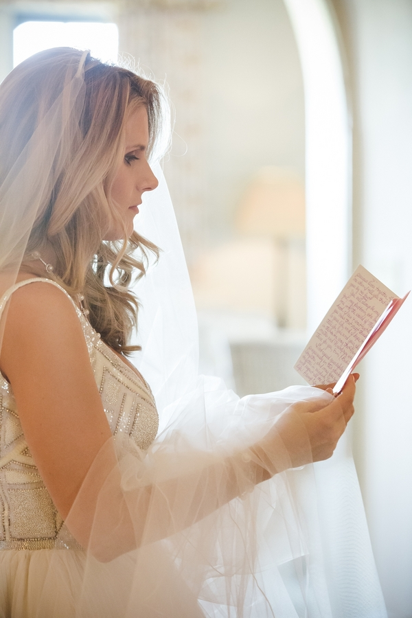 Bride reading a note from her Groom