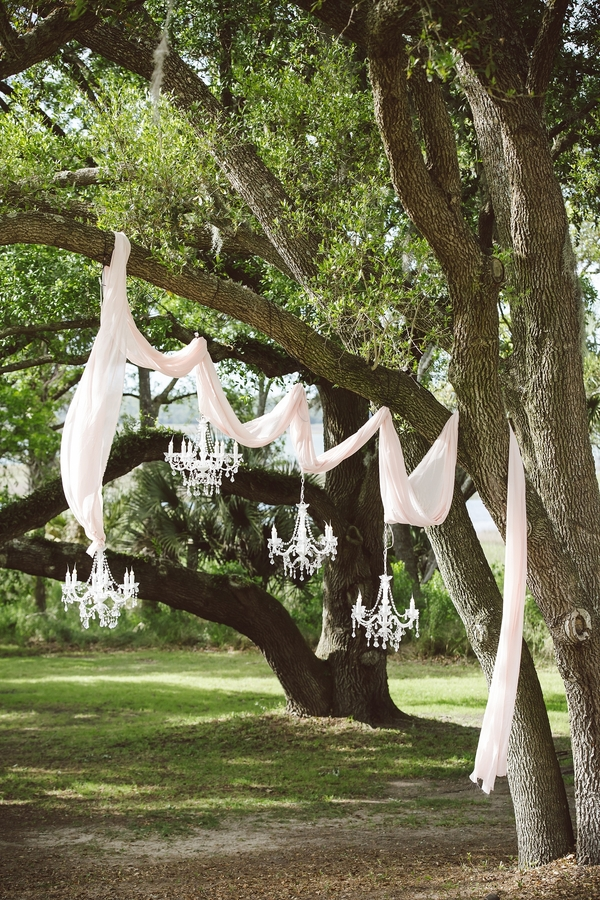 Ceremony set up with draping and chandeliers