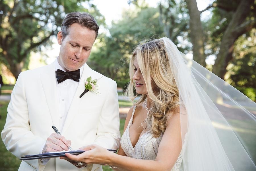 Bride + Groom signing their marriage certificate