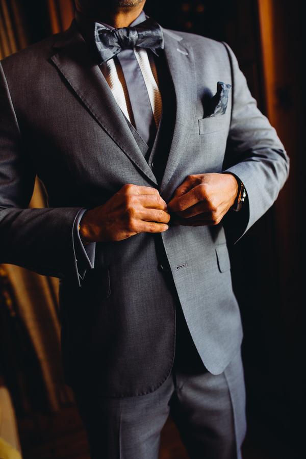 Groom in grey suit