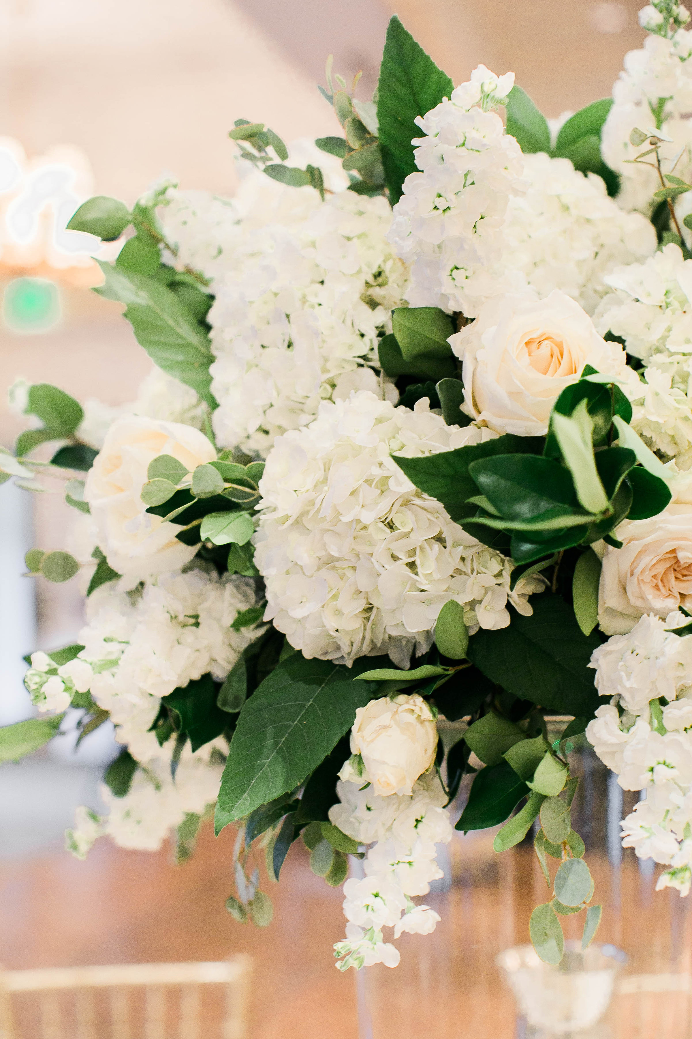 All white hydrangea and rose centerpiece by Fernwood Floral