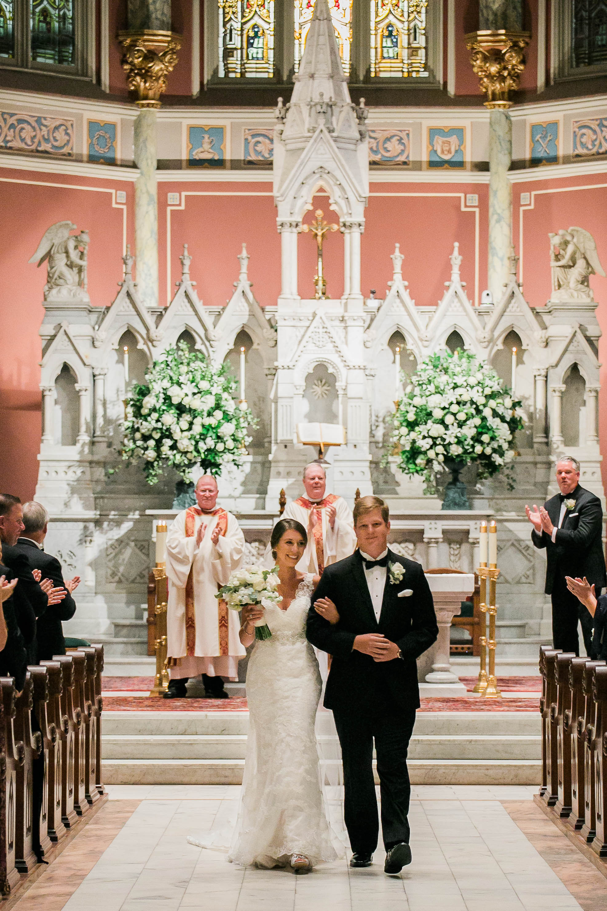 Traditional wedding ceremony at The Cathedral of St. John the Baptist in Savannah, Georgia