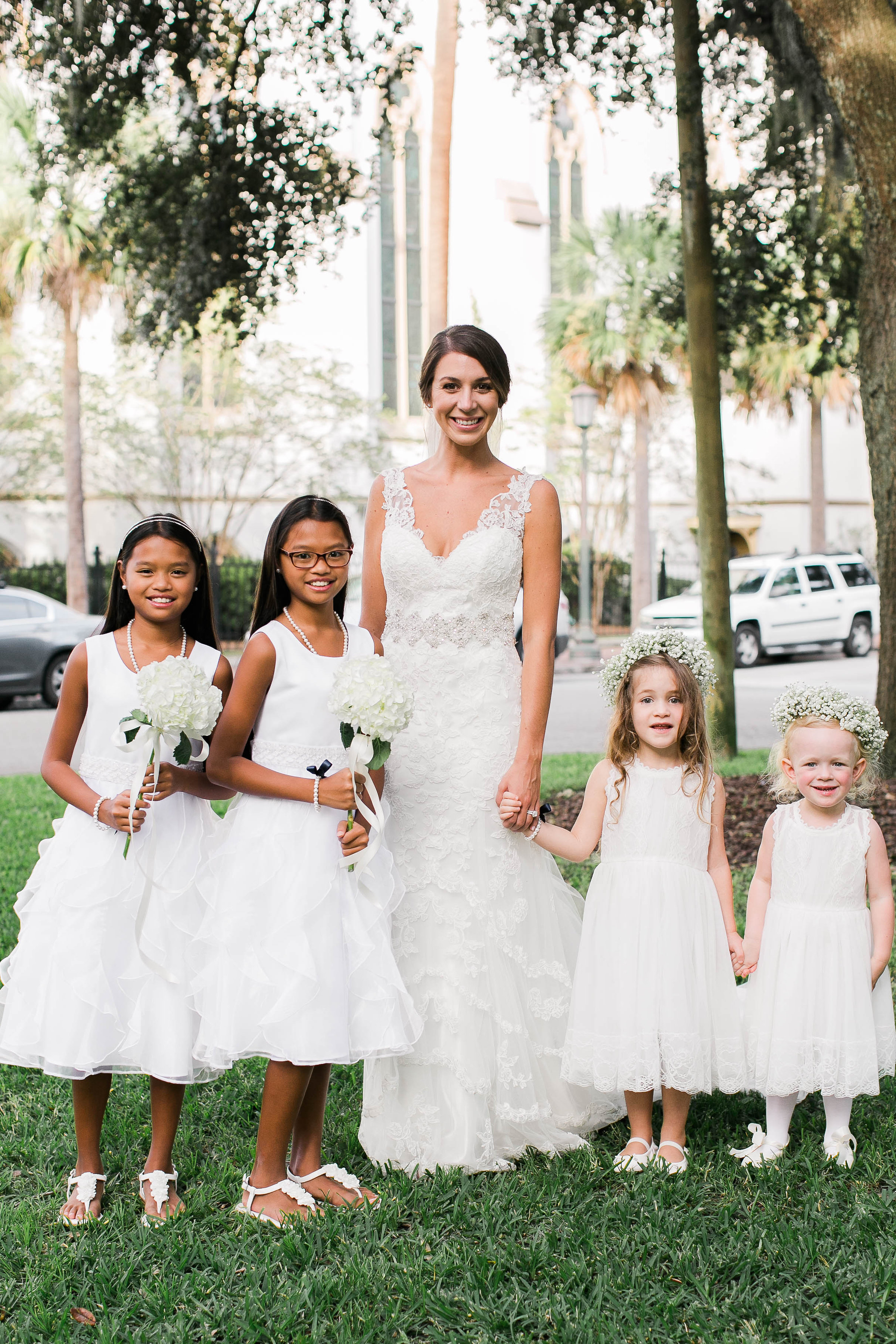 Bride in Martina Liana gown with flower girls