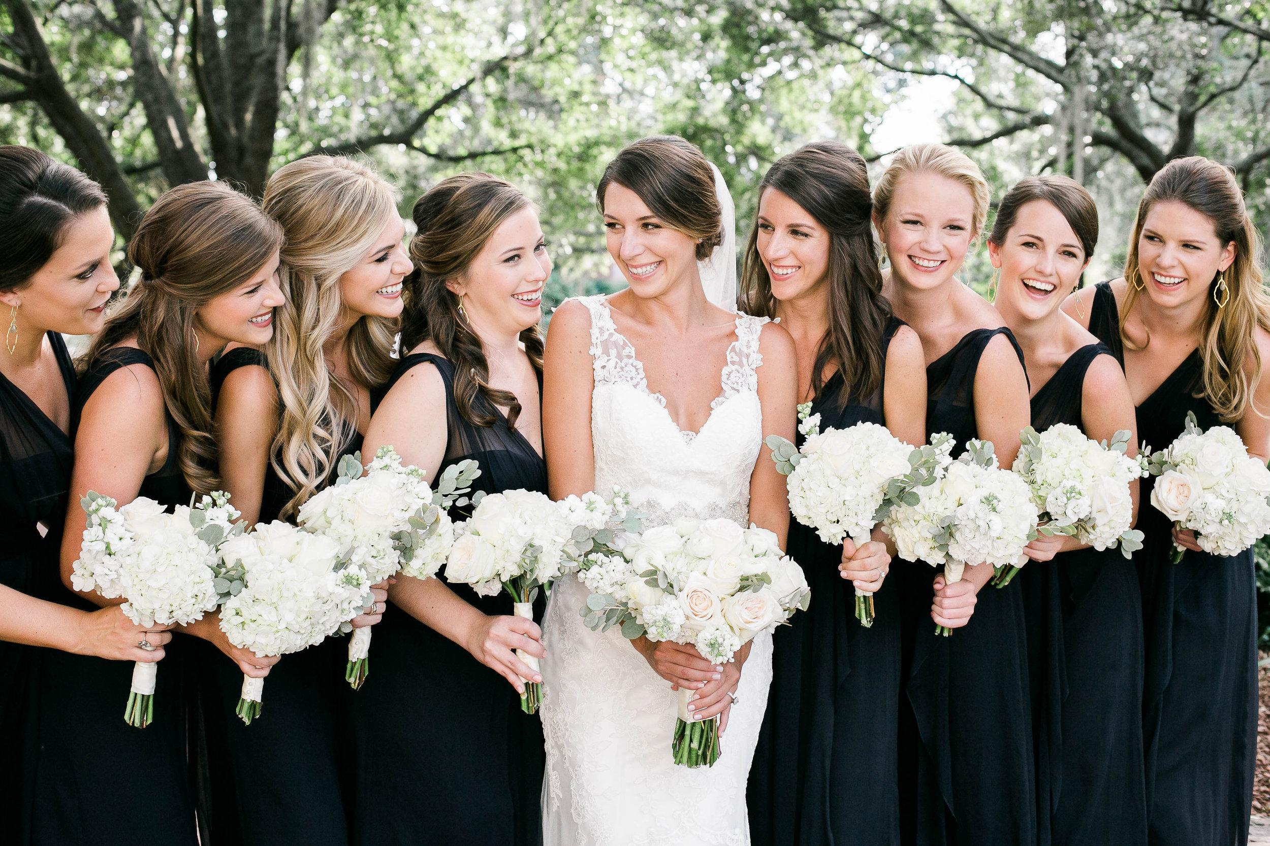 Long navy Amsale bridesmaids dresses from Bleubelle Bridal in Savannah, GA