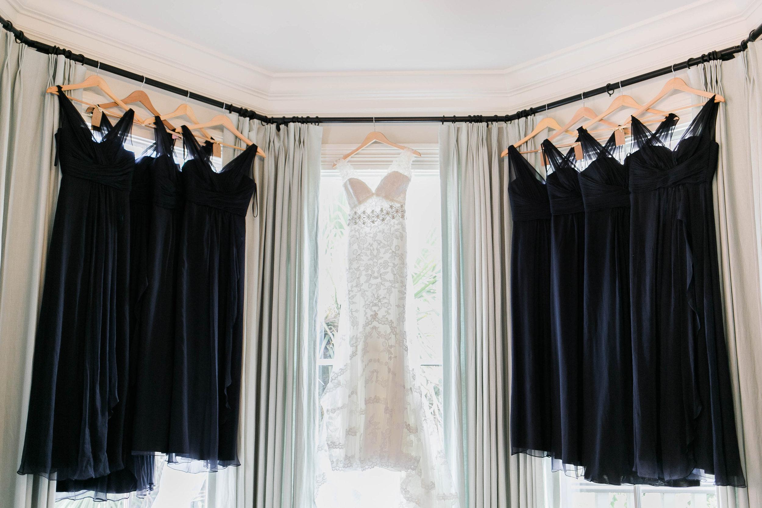 Long black Amsale bridesmaids dresses from Bleubelle Bridal in Savannah, GA