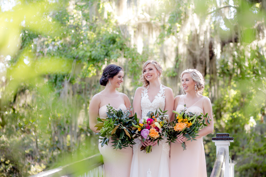 Bride and her bridesmaids on the bridge at Magnolia Plantation and Gardens