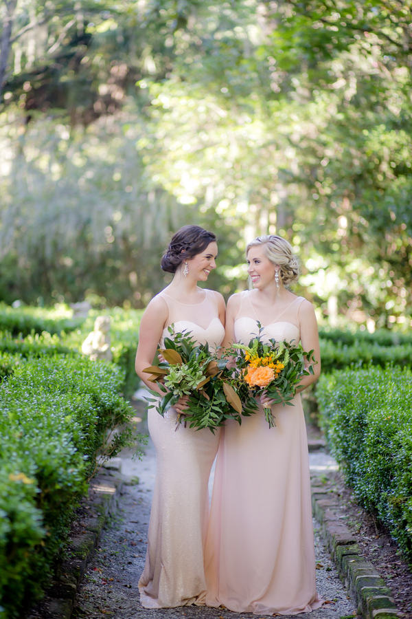Bridesmaids in neutral dresses at Magnolia Plantation and Gardens