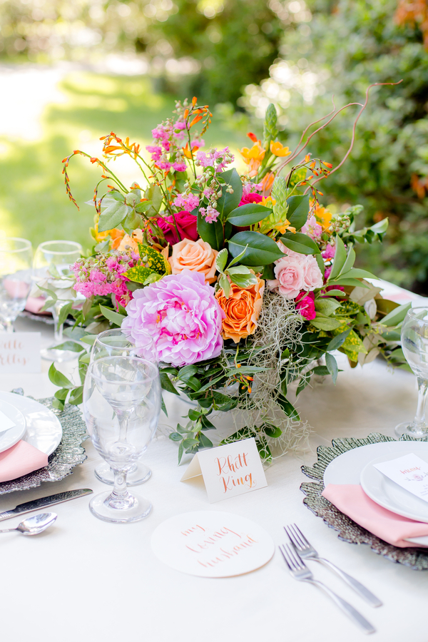 Pink, orange and blush colored centerpiece by Pretty Petals of Charleston