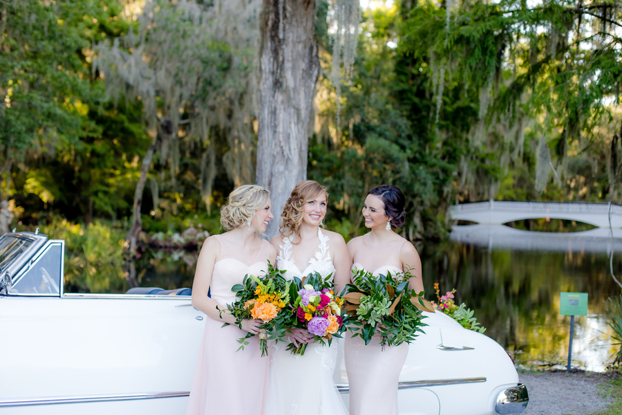Bridal party in front of vintage car at Magnolia Plantation and Gardens