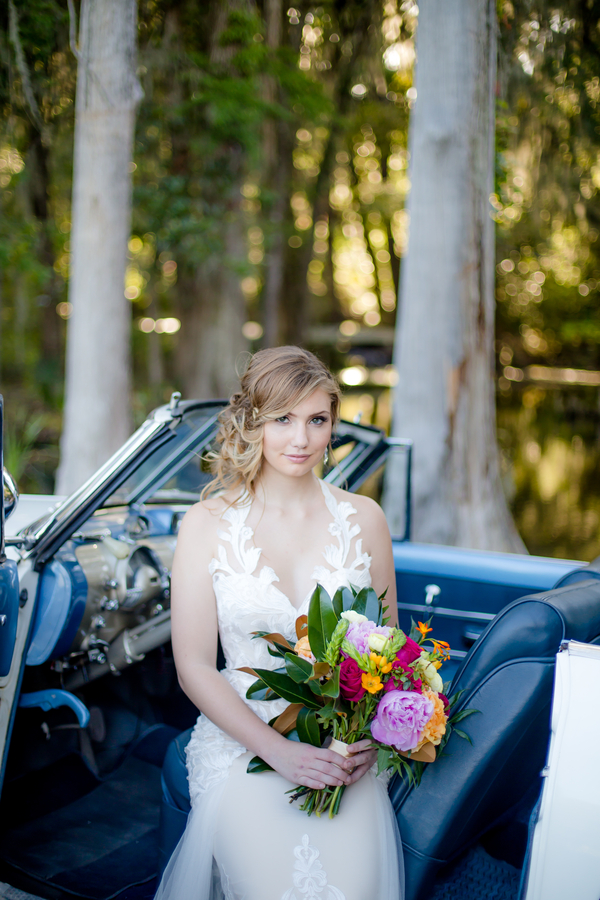 Charleston bride in vintage car from Lowcountry Valet & Shuttle Co.