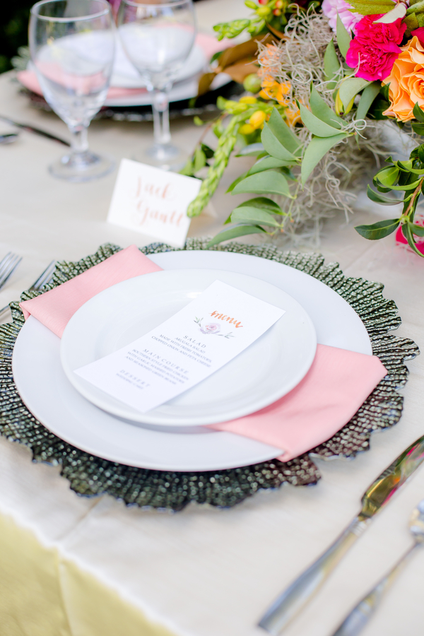 Place setting with menu cards at wedding in Charleston, SC