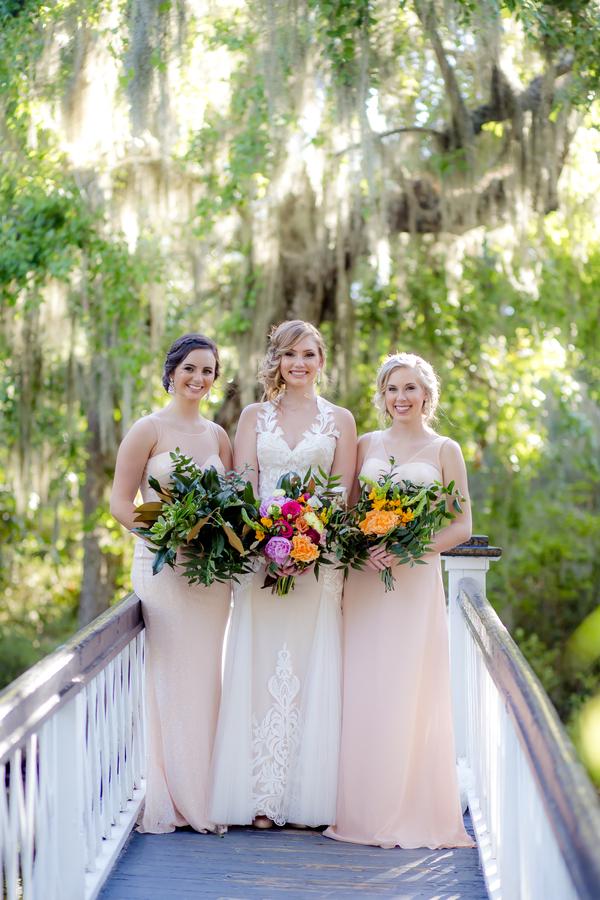 Bride and her bridesmaids on the bridge at Magnolia Plantation