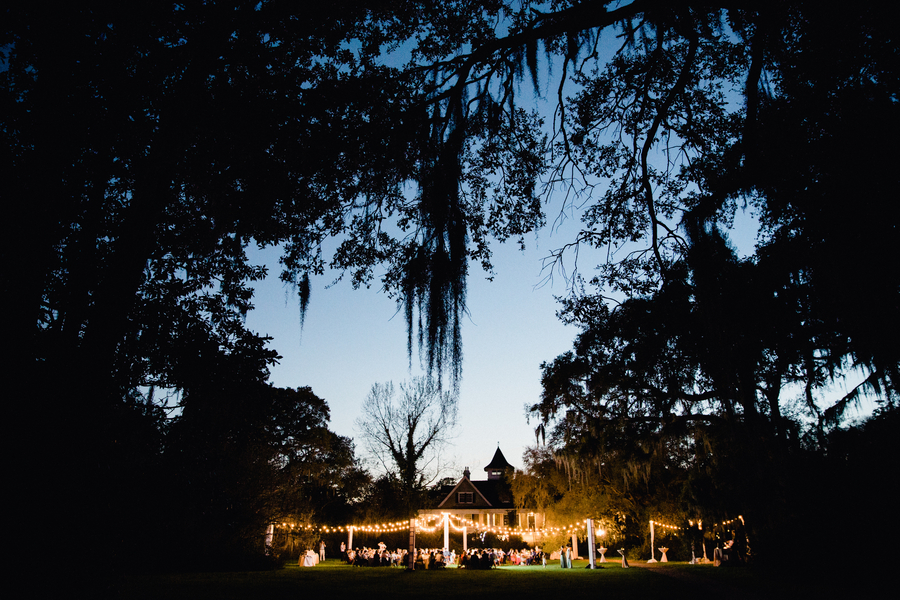 Brittany & Stephen's Charleston, South Carolina wedding at Magnolia Plantation  //  Elegant two-tiered white wedding cake with pink peony accents in Charleston, SC //  Charleston wedding photos on A Lowcountry Wedding Magazine & Blog