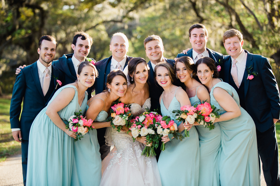 Bridesmaids in long mint dresses and groomsmen in navy suits for wedding in Charleston, South Carolina  //  Charleston wedding photos by Phillip Casey Photography on A Lowcountry Wedding Magazine