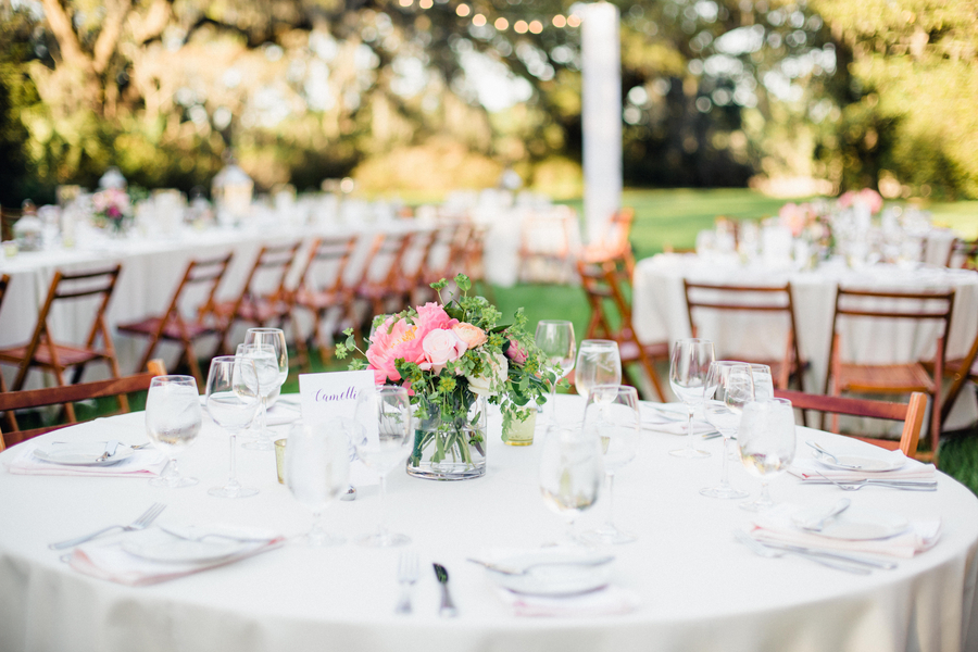 Pink peony centerpieces at Magnolia Plantation & Gardens by Duvall Events // Charleston wedding florist on A Lowcountry Wedding Magazine