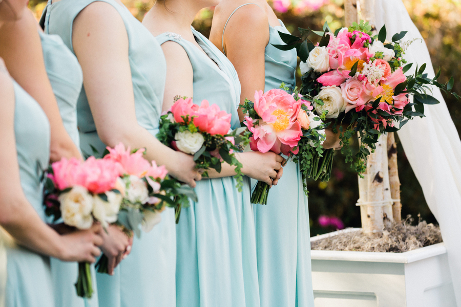 Bridesmaids with pink peony bouquets at Outdoor wedding ceremony // Charleston wedding photography on A Lowcountry Wedding Magazine