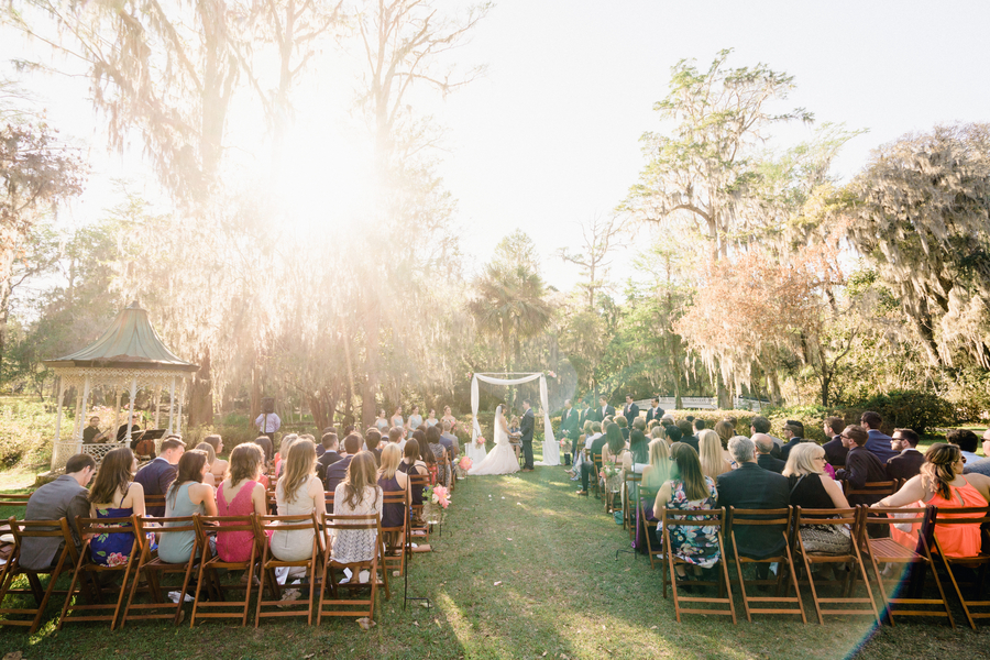 Outdoor wedding ceremony in the gardens at Magnolia Plantation // Charleston wedding photography on A Lowcountry Wedding Magazine