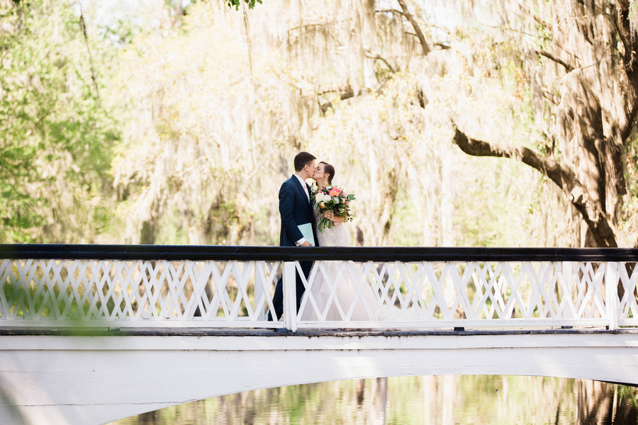 Brittany & Stephen's First look on the white bridge at Magnolia  / Charleston wedding photos by Phillip Casey Photography - A Lowcountry Wedding Magazine