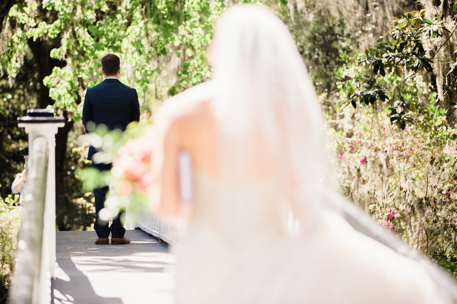 Brittany & Stephen's First look on the white bridge at Magnolia Plantation  / Charleston wedding venue on A Lowcountry Wedding Magazine