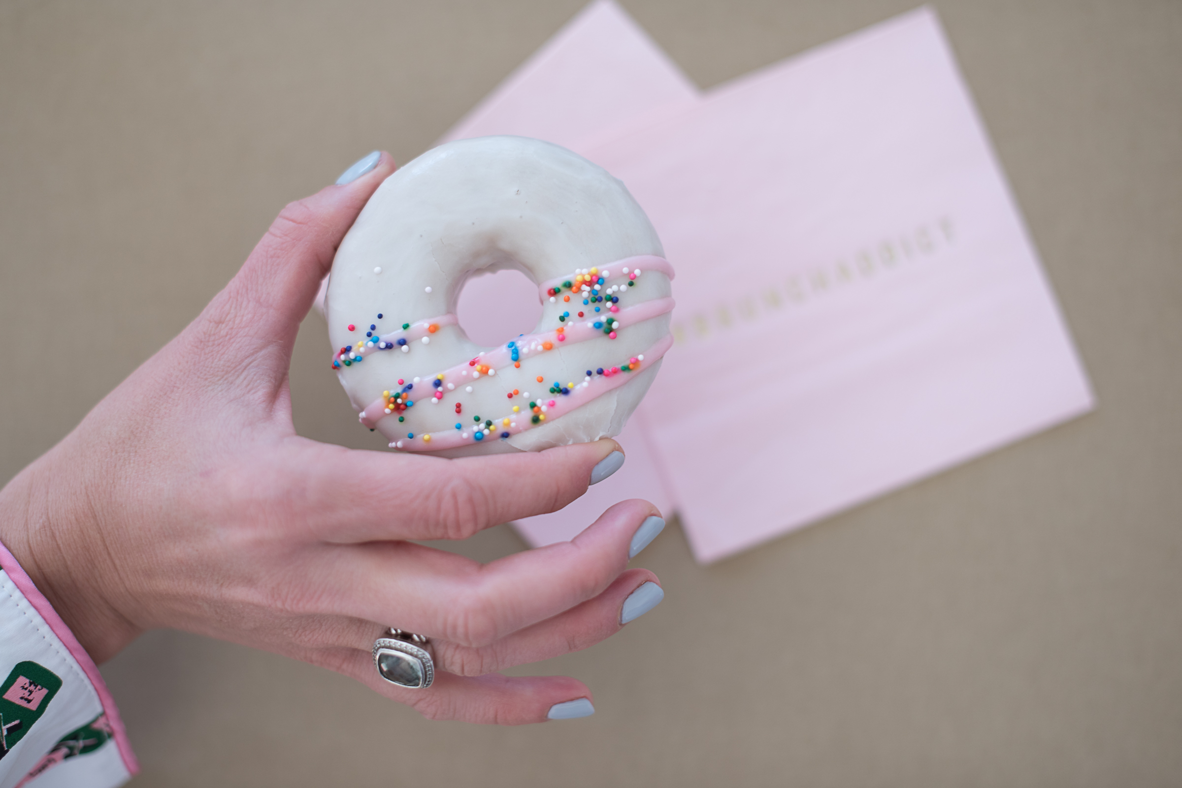 Valentine's Day doughnuts with pink stripes and sprinkles  //  designed by Charleston Weekend  //  on A Lowcountry Wedding Magazine