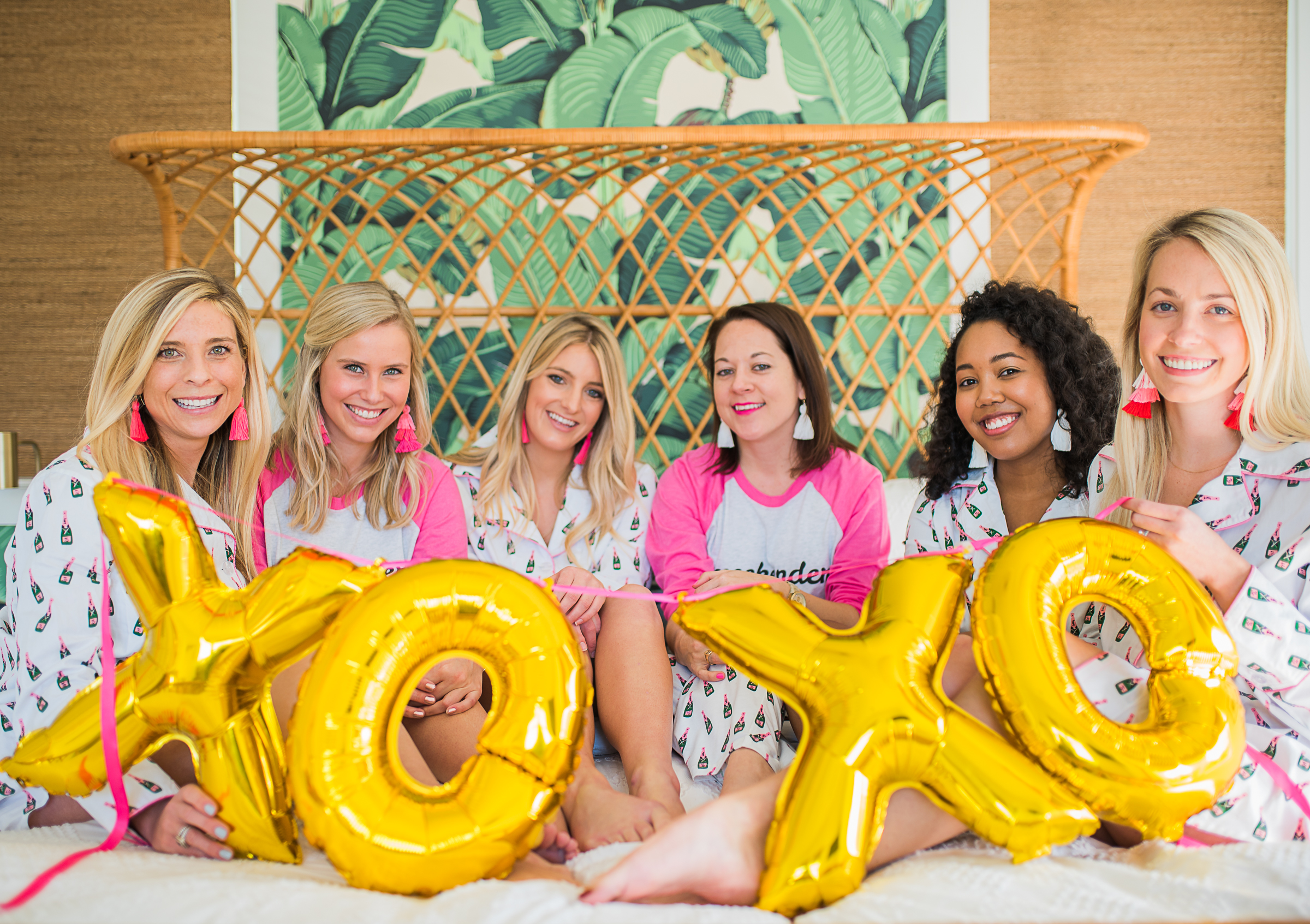 Girls slumber party with green palm leaf wallpaper  //  gold X O inflatable balloons from The Cannonborough Collective //  on A Lowcountry Wedding Magazine