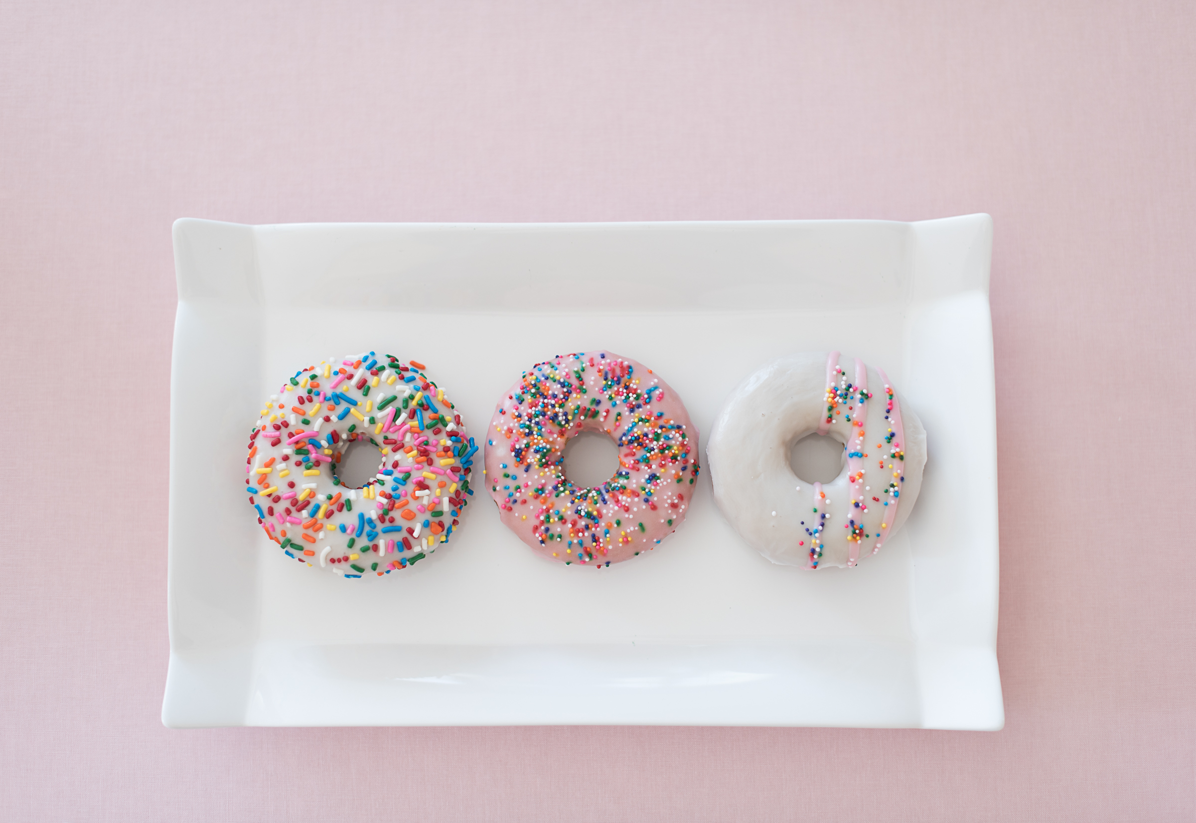 Three pink sprinkled doughnuts  //  Charleston photos by Aneris Photography //  on A Lowcountry Wedding Magazine