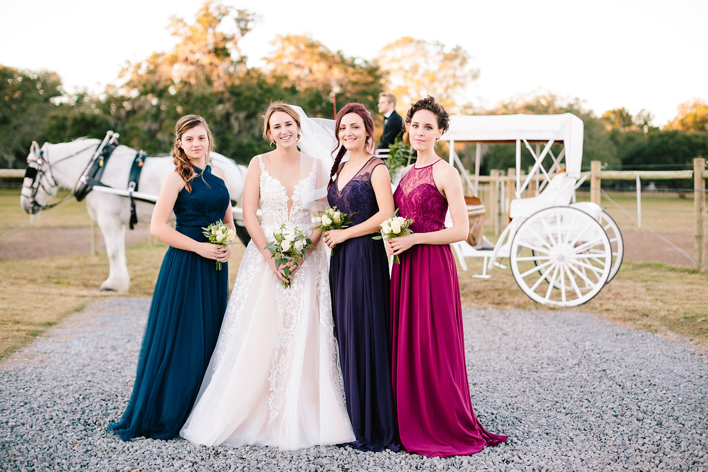 Bride and her maids at Sugah Cain Plantation in front of white horse and Carriage  //  on A Lowocountry Wedding Magazine & Blog