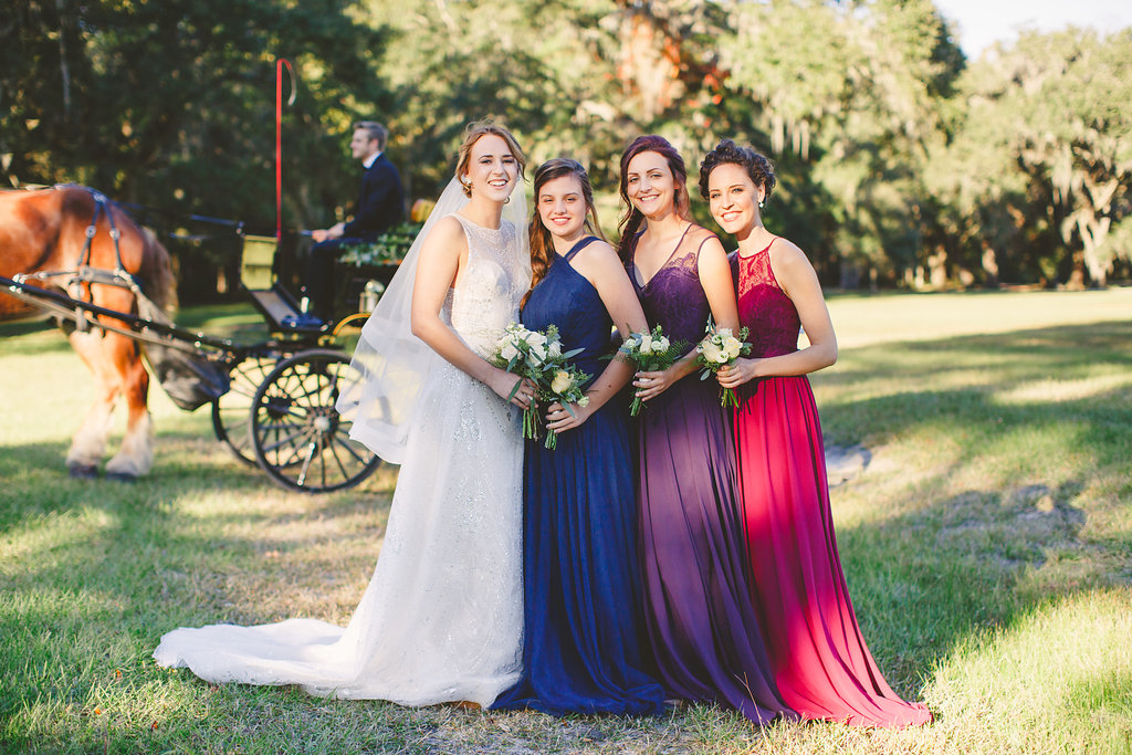 Bridesmaids in long Hayley Paige dresses at Sugah Cain Plantation  //  Charleston, SC bridal boutique  //  Bride and her maids at Sugah Cain Plantation in front of white horse and Carriage  //  on A Lowocountry Wedding Magazine & Blog