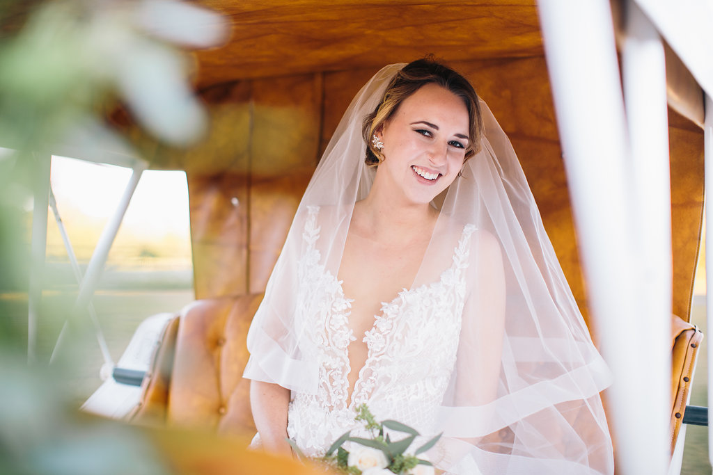 Charleston, SC bride in a horse and carriage at Sugah Cain Plantation  //  Old South Carriage Company  //  Charleston wedding photography by Carolina Photosmith